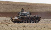 Turkey vows to fight Islamic State, coalition strikes near border