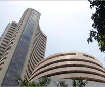 Sensex rises over 300 pts on global cues