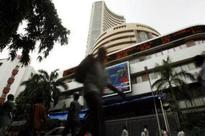 Sensex gains to near record highs; IT stocks recover
