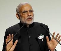 Modi talks tough at Paris climate summit, warns against restrictions