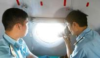 Mystery deepens: Search planes scour sea for missing Malaysian jet