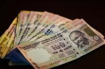 Rupee closes flat against US dollar at 66.56