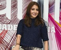 Current Bollywood News & Movies - Indian Movie Reviews, Hindi Music & Gossip - Anushka Sharma REACTS to the backlash she received for being included in the Team India photo by BCCI
