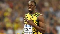 Rediff Sports - Cricket, Indian hockey, Tennis, Football, Chess, Golf - Usain Bolt celebrates the day he beat himself to become fastest man on Earth