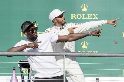 Rediff Sports - Cricket, Indian hockey, Tennis, Football, Chess, Golf - Hamilton wins US GP but made to wait for title
