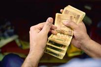 Rupee trades lower at 67.82 against US dollar