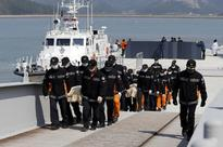 South Korea recovers first bodies from inside sunken ferry
