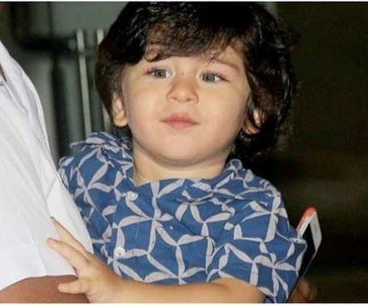 Current Bollywood News & Movies - Indian Movie Reviews, Hindi Music & Gossip - Taimur tells paparazzi his name is 'Tim'