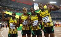 Bolt lands sprint sweep, Farah the treble double