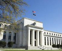 Fed stays patient on hiking rates, says US economy on track despite global turmoil