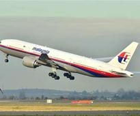 Malaysia probes passenger backgrounds for clues on missing flight