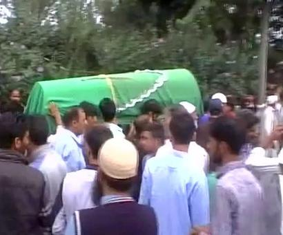 Mourners attend funeral for constable Khursheed Ahmed who was killed by terrorists in J&K