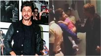 Current Bollywood News & Movies - Indian Movie Reviews, Hindi Music & Gossip - Watch: This video of Shah Rukh Khan kissing a kid at Mumbai airport on returning from the US is adorable!