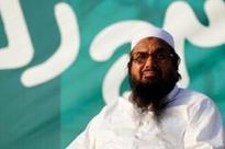 Pak cancels Saeed's licences