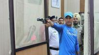 Rediff Cricket - Indian cricket - Dhoni pays visit to Kolkata Police Training School for shooting session