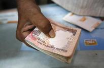 Rupee slumps to three-month low on dollar buying by state-run banks