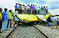 19 die as train rams into school bus in southern India