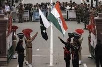 Pakistanis turn flag ceremony near Indian border into rally
