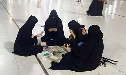 Burqa-clad women playing board game at Mecca mosque spark controversy
