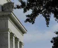 Fed upbeat on U.S. economy, cites strong job gains