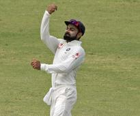 Rediff Cricket - Indian cricket - Virat Kohli Does Not Take Off His Batsman's Hat Even While Fielding