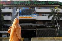 Sensex, Nifty scale record highs