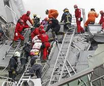 Rescuers race to save survivors