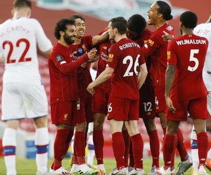 EPL PIX: Liverpool move closer to title; United in top-four hunt