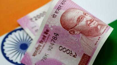 Rupee erases early gains, trades flat at 75.78 per dollar