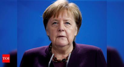 Angela Merkel condemns 'poison' of racism after Hanau shootings