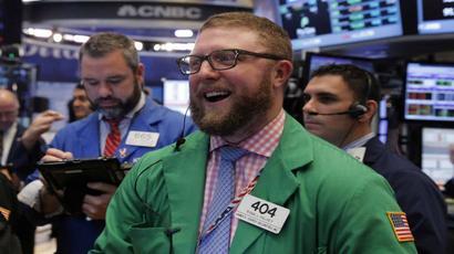 Wall Street hits record high on trade optimism, FAANG rally