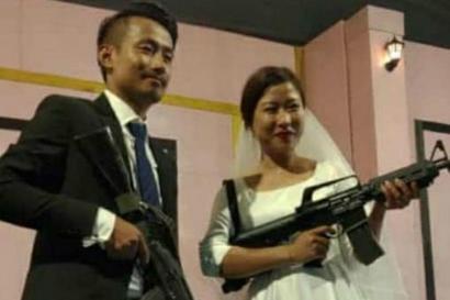Naga Rebel's Son, His Wife Brandish Automatic Rifles at Their Wedding Reception