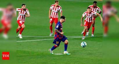 Messi scores 700th goal but Atletico draw hurts Barcelona's title hopes