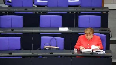 Exasperated Merkel backs widening boardroom quota for women