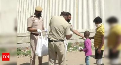 Cops distribute food, essential commodities