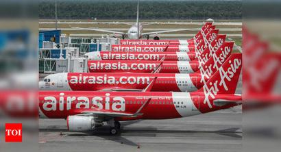 AirAsia news: AirAsia in trading halt after auditor flags 'going concern' doubts - Times of India